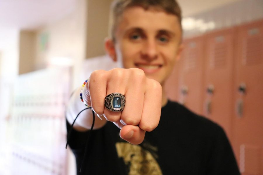 Tommy+Tye+poses+with+his+class+ring+that+he+designed+and+ordered+his+junior+year.+Photo+by+SHoehn.