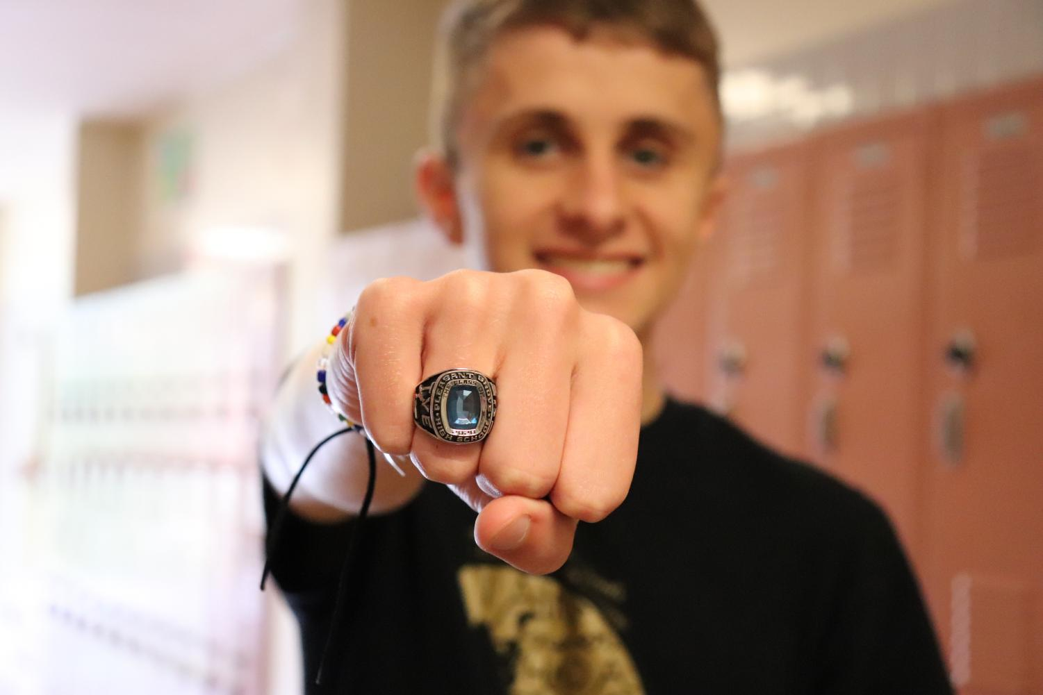 Tommy Tye poses with his class ring that he designed and ordered his junior year. Photo by SHoehn.