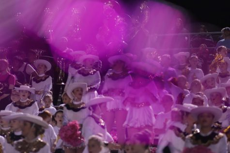 A colorful pink view of the Showstoppers at the Pink Out game against Gilmer. The Hawks beat the Buckeyes 37-24.