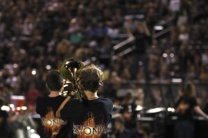 The band performs their full show during a home football game earlier this school year.