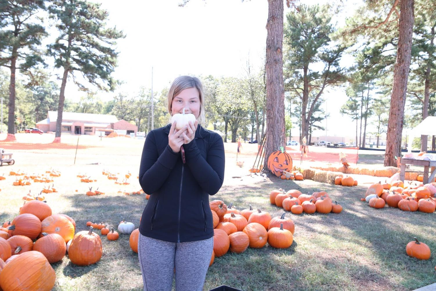 Sophomore Kelsey Clark holds up her own special pumpkin from Williams Memorial.