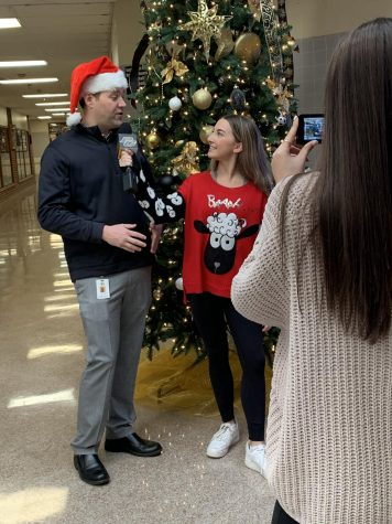 PGTV Producer Chloe Carpenter (12) interviews Principal Marshall about important student deadlines coming up. The interview was apart of PGTV's weekly Friday show, which was Christmas-themed this week.