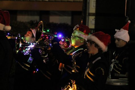 Baritone Jessi Vanderhoeven (11) plays a Christmas song with the band during the parade.