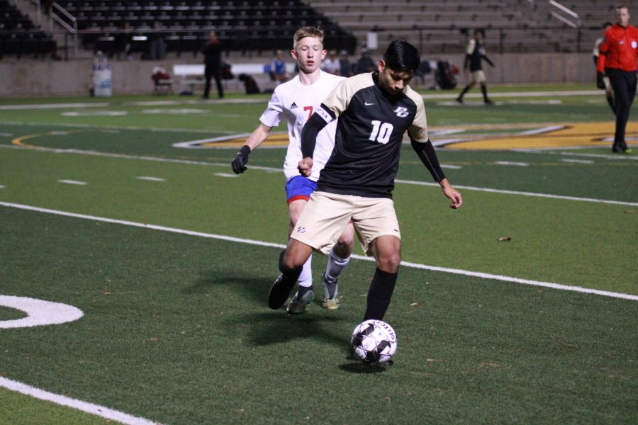 Senior Captain Anthony Mejia blocks a Sabine player from getting the ball. Anthony is one of two captains for the varsity team. Against Sabine, he felt that the team's effort improved.