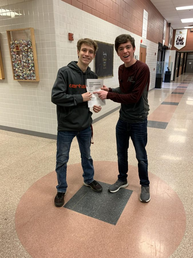 Junior Carson Sanders and senior Clay Jones display the letter notifying them that their film qualified for the UIL State Film contest.