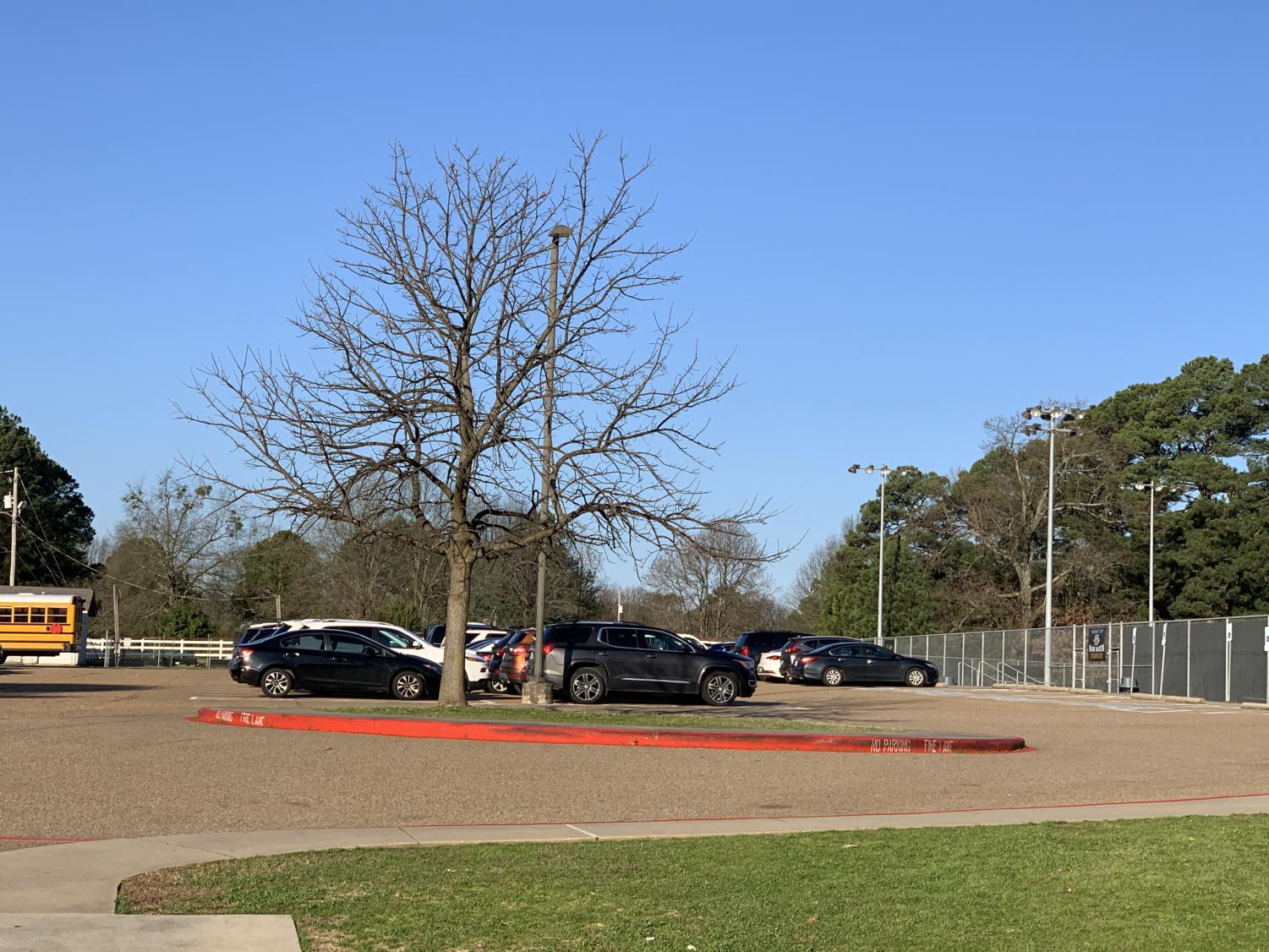 An image of the student parking lot, filled with cars now that the administration no longer allows students to park in the back lot.