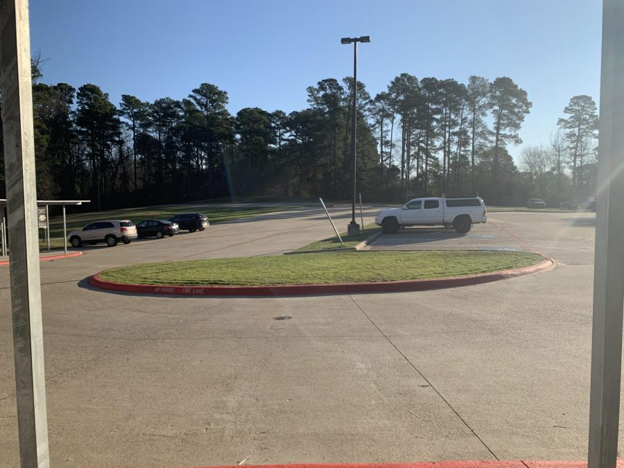 Here's how the back parking lot looks after the new rule against students parking here. Other than 5 or 6 cars, the lot is now empty.