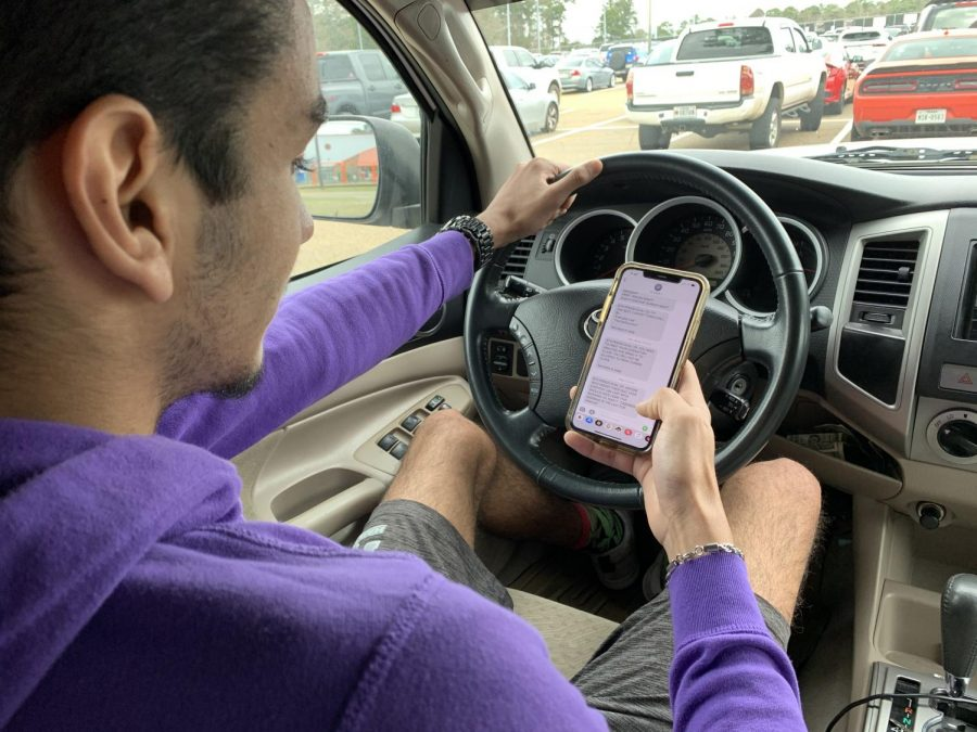 Senior Enrique Navedo sits in his truck mindlessly looking at his phone. According to Teendriversource.org, high school students that use their phone while driving are less likely to wear a seatbelt, and more likely to drive and drive.