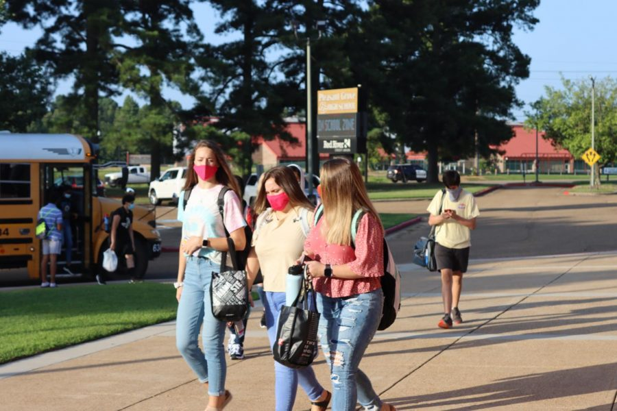 Students walk in wearing masks on the first day of school. PGHS started back on Aug. 10.