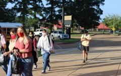 Students walk to class on the first day of school.