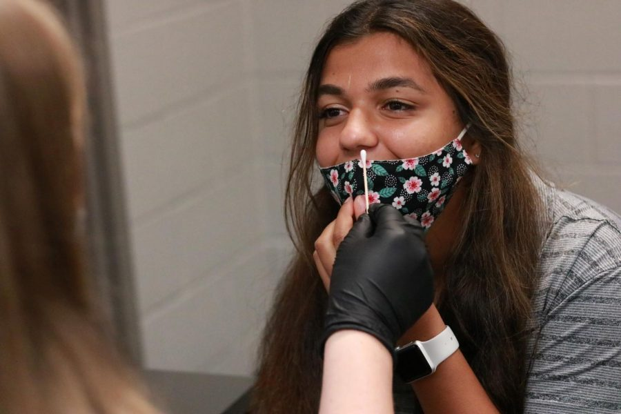 Sophomore Supriya Sharma practices getting a COVID-19 nasal swab test in Health Science.