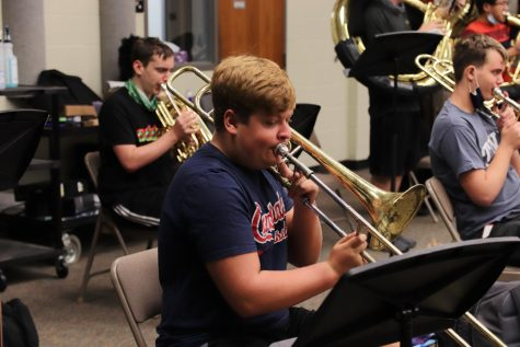 Junior Ethan Hadaway plays his trombone during band practice.